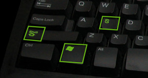 cropped photo of a Dell keyboard featuring the windows, shift, and s keys highlighted in green